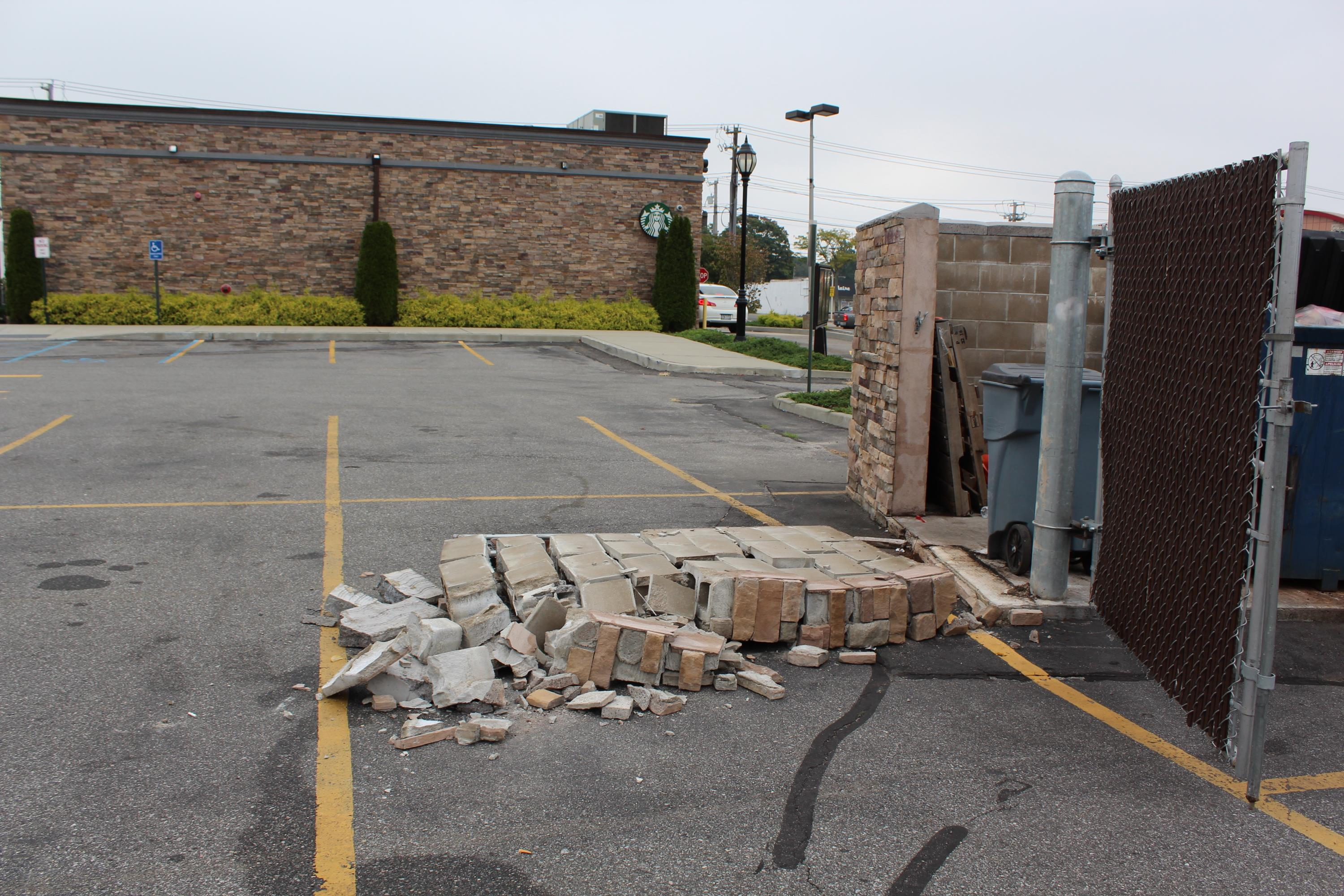 Broken Dumpster Enclosure - Starbucks Babylon
